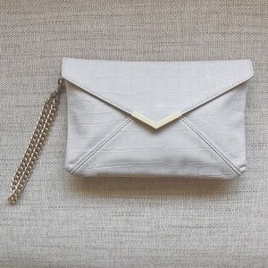 EXPRESS TAUPE SNAKE + GOLD CHAIN HANDLE CLUTCH